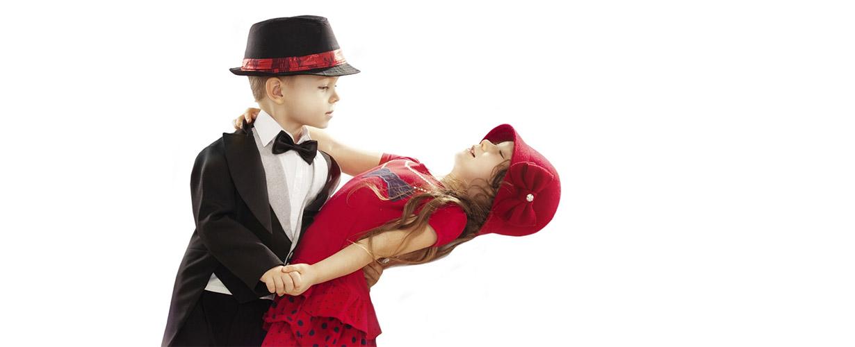 Little boy and girl ballroom dancing